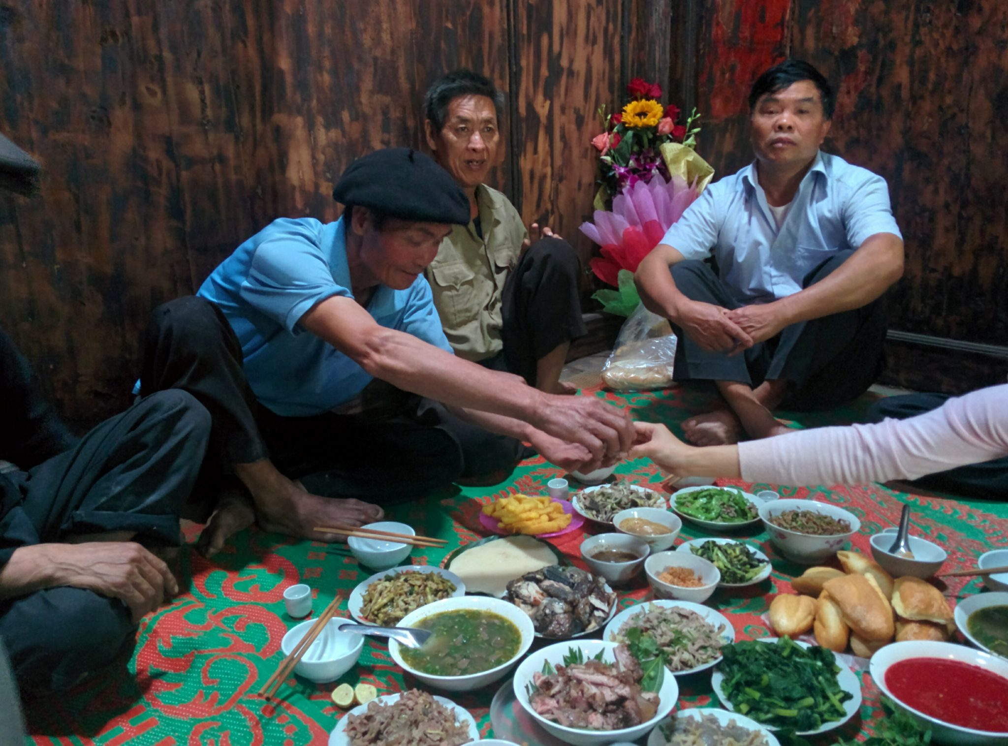 food with locals in ha giang - 10 local foods not to miss while in Vietnam